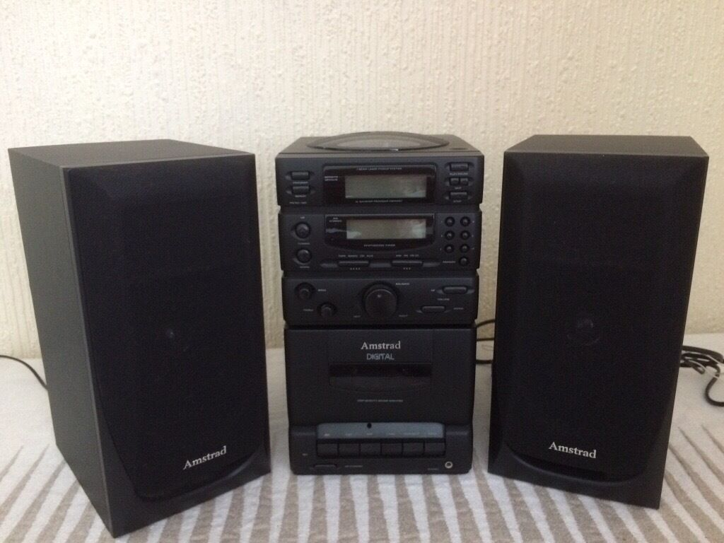 Amstrad Compact Hi Fi Unit With Speakers And Remote