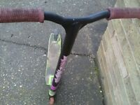 Stunt slam scooter good condition . black green and purple unisex .cost 70 pounds .
