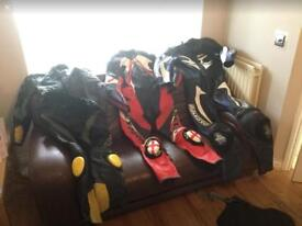 3 sets of motorbike leathers