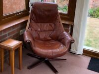 pair of swivel & tilt leather chairs
