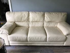 Large, cream leather, 3 seater sofa, one armchair and footstool.