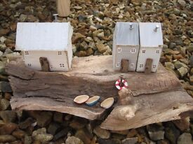 Handmade wooden cottages. Coastal/seaside theme. Made from recycled scraps of wood etc.