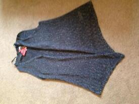 Knitted shimmery sleeveless cardigan