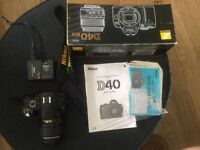 Nikon D40 kit includes 18-55mm lens, charger, battery and strap