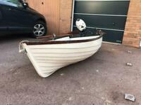 Fishing boat. Fibre glass dinghy. Rowing boat with YAMAHA outboard engine