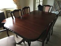 Mahogany dinning table and six chairs including two carvers.