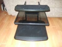Black TV stand - was used for a 22 inch TV - with centre glass shelf + base shelf