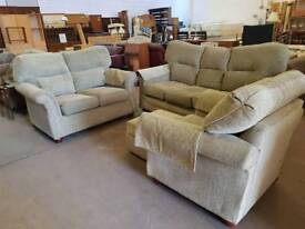 Green patterned fabric three seater sofa with two seater and chair