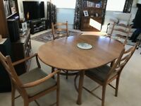 Vintage Ercol solid wood dining table and 6 chairs