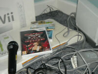 nintendo wii console with games board control and mic