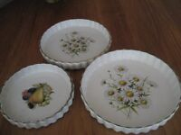 One 7 inch, one 8 inch and one 9 inch ceramic flan dishes.