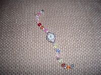 Flower face ladies watch with colourfull beads and a magnetic clasp