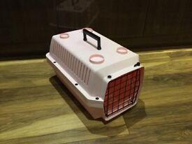 Pink cat carrier.