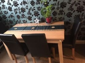 Dining table with 4 black leather chairs