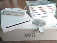 Nintendo Wii w/ 6 Games & gun addon (Great condition w/box)