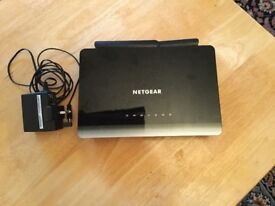Netgear d 3600 with adaptor 1year oldperfect working order £25 can deliver if local 07812980350