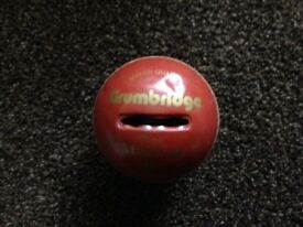 Cricket ball money box