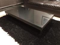 Glass top carbon fibre effect coffee table