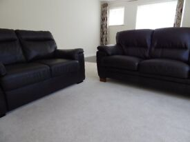 Two Leather Look Sofas