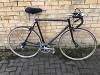 Black racing road bike cxcdxxc