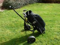 GOLF SET Trolley,bag and selection of irons - would suit beginner.