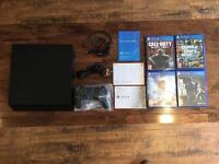 AS NEW - PlayStation 4 with box and 4 games - switched on 3 times only!