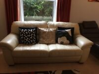 Two seater cream leather John Lewis sofa. Used a few marks.