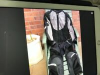 Revit ladies 2 piece Textile motorcycle suit with full body armour in immaculate condition