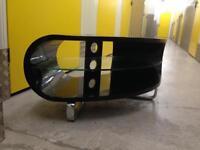 Sleek black designer corner tv stand