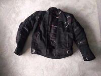 Used Twice. Cost £180 RST Pro Series Ventilator 5 Textile motorbike Jacket - Black. Medium. Armor