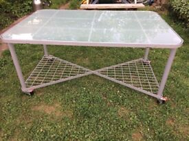 Large frosted glass table on wheels