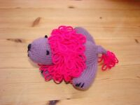 Hand knitted Lion. Purple with Fuschia pink mane & tail.