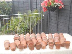 0ver 100 old vintage hand thrown terracotta pots