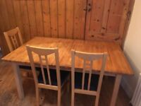 Extendable dining table and three chairs