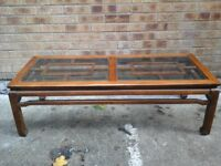 Large dark Oak coffee table with squre wood pattern under 2 glass tops