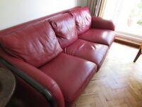 3 seater leather sofa and 2 armchairs (red with black wooden border)