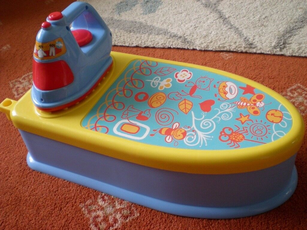 Toy travel ironing board with storage, and iron in great condition.