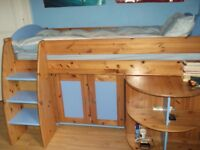 Beautiful raised single bed with storage/extending desk