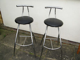 wo Chrome Bar Stools with black leatherette seats. (plus wooden stool if you want as well)