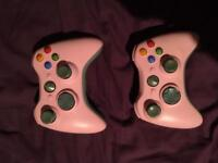 2 pink Xbox 360 controllers