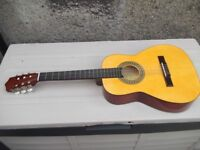 Three quarter size acoustic guitar by 'Artist'. sold with case and two books/cd's