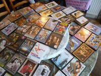 66 dvd's with original covers,mostly indian bollywood selective movies,few hollywood etc..