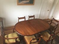 Georgian-style double-pillar dining table and six chairs. Extends to 8 seater. Excellent condition.