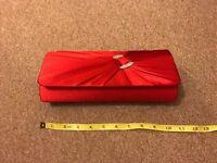 Red satin clutch bag