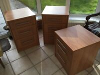 Three Schreiber wood and veneer bedside tables with drawers and brushed chrome handles