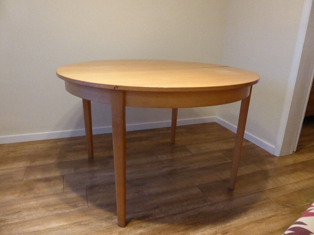 Beech effect extendable dining room table with chairs