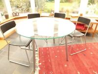 GLASS TOP TABLE AND STACKING CHAIRS