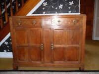 Oak cupboard with brass drop handles