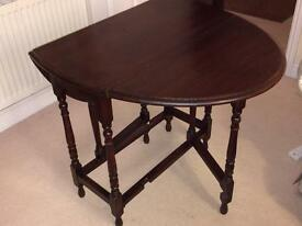 Solid dark wood leaf side table
