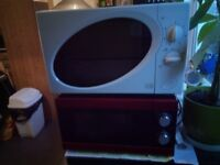 Two microwaves (dark red and white)